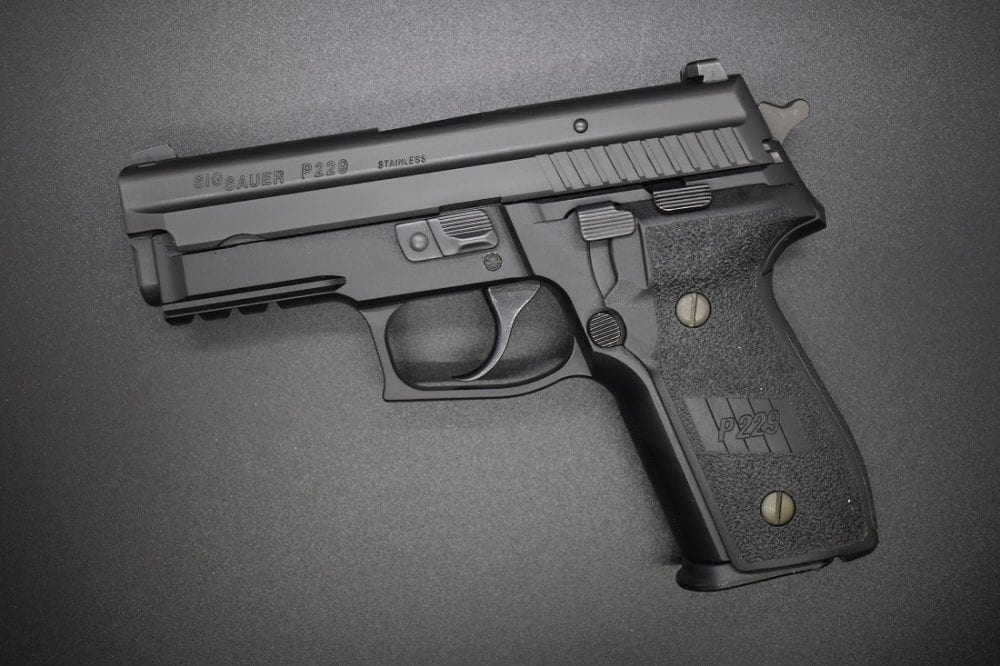 Sig P229R 9mm pistol with an SRT trigger on a black background