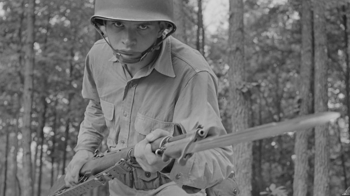 Fort Belvoir, Virginia. Sergeant George Camblair learning to use the bayonet 1942 M1