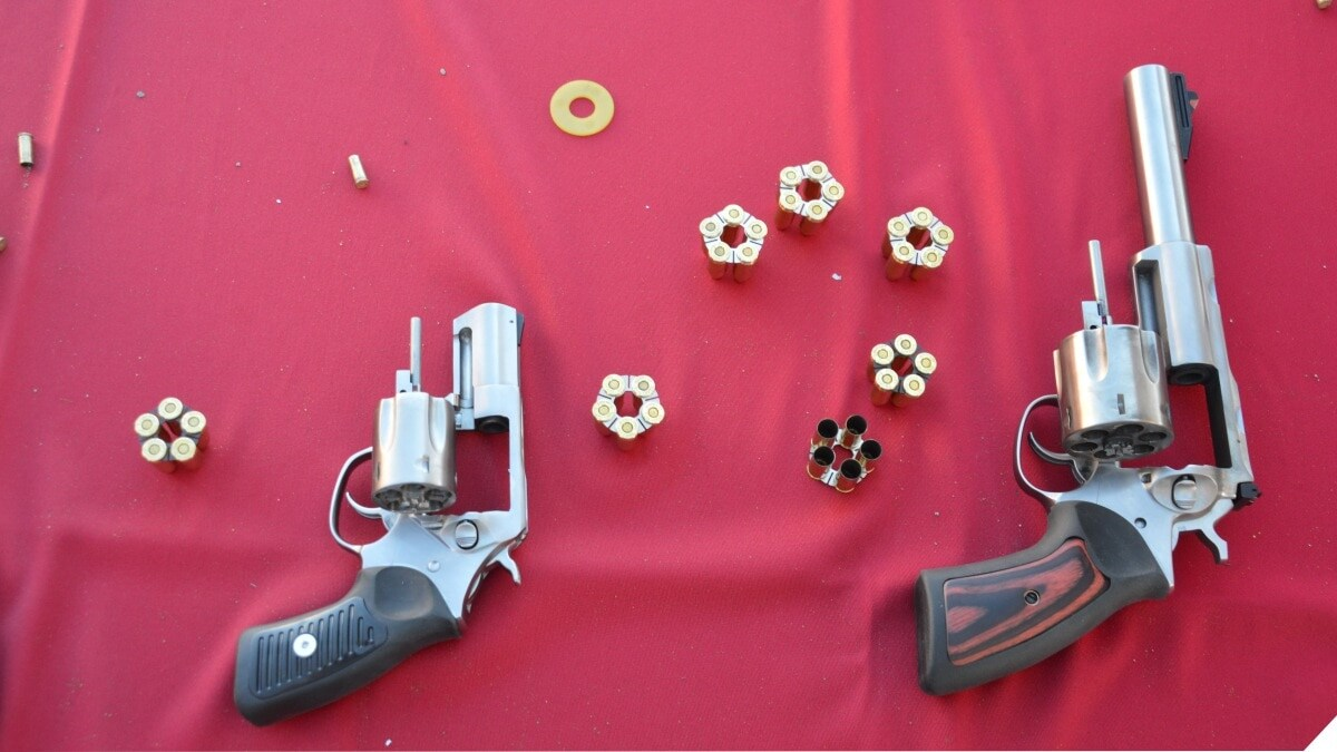 Ruger revolvers on a red table