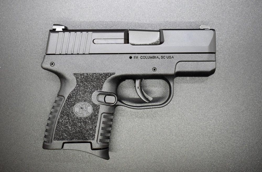 A small black 9mm handgun, the FN 503