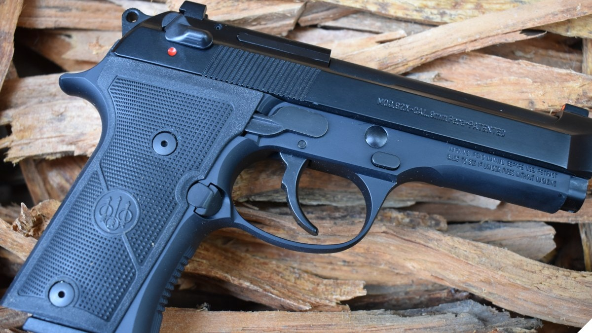 Beretta 92X 9mm pistol on a pile of tender
