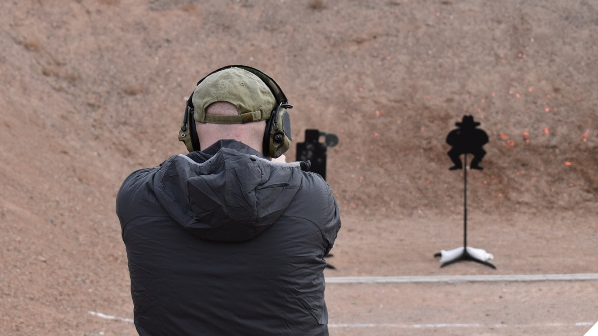 A man shoots on an outdoor shooting range