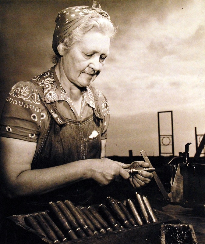 """Netherlands-born Mrs. Catherine Melker, the 58-year old former dress designer and teacher, is one of the most ardent and hard-working ""WOWS' at Dahlgren Proving Grounds. She is greasing bullets for the test-firing lines."