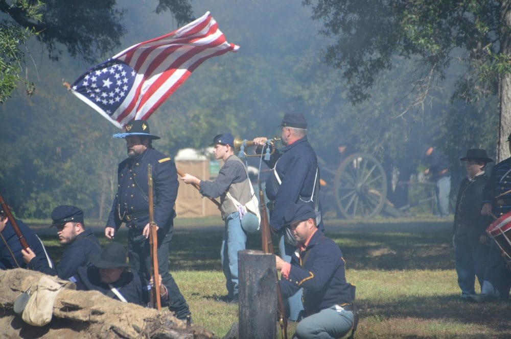 "Civil War reenactors with a popular variant of the 34-star U.S. flag. A 19th Century Massachusetts-born sea captain, William Driver, defiantly flew his old flag from his Nashville, Tennessee, house during the conflict, reportedly telling a mob that came to take it down, ""If you want my flag you'll have to take it over my dead body."" According to legend Driver was the first to term it, ""Old Glory."" (Photo: Chris Eger/Guns.com)"
