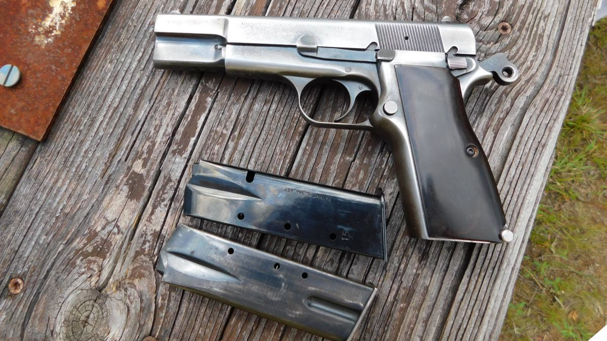 An aged Browning Hi-Power T-series on distressed wooden table