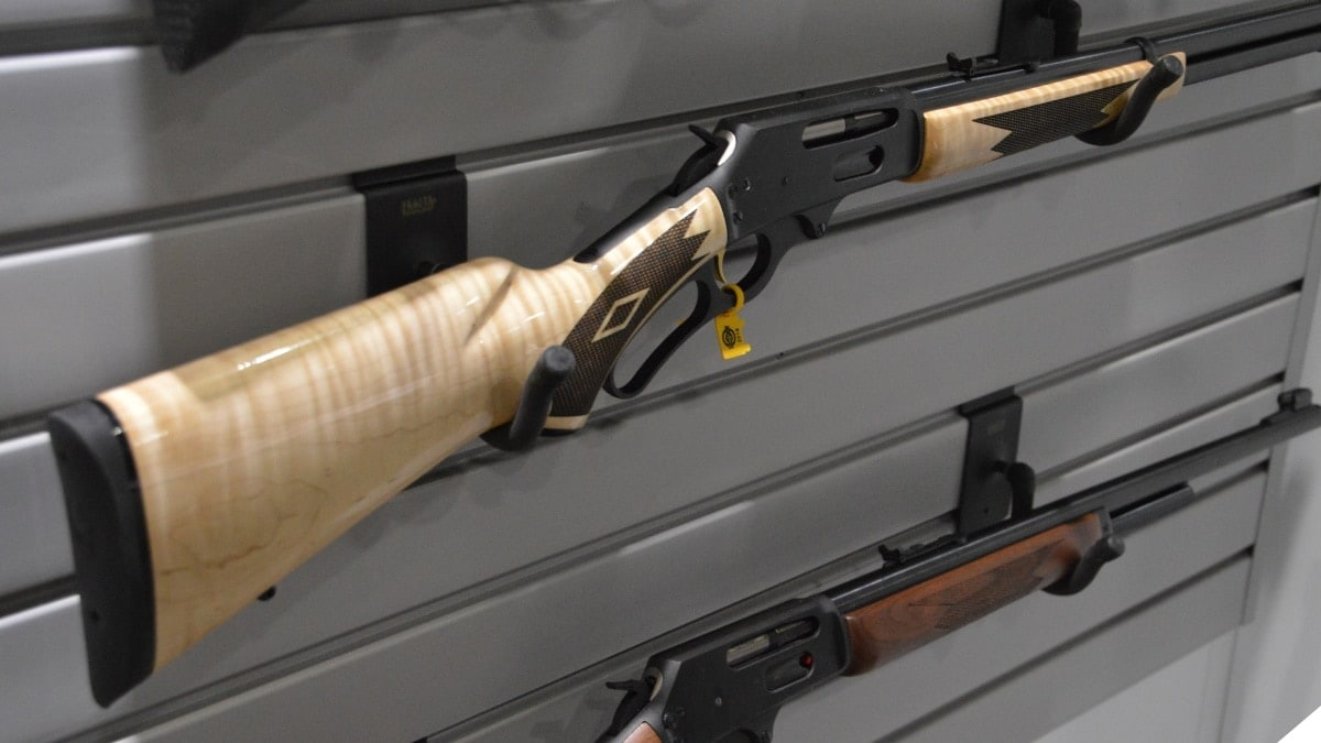 A rack of Marlin lever-action rifles on a wall display