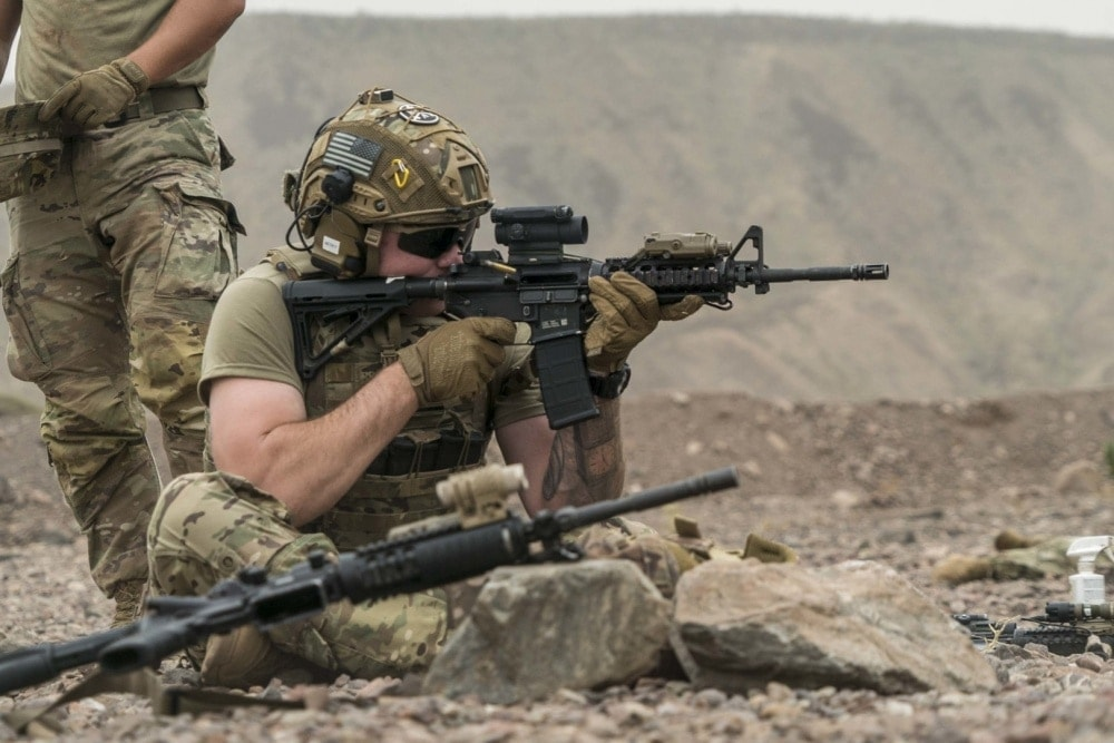 U.S. Army Spc. Cody Meracle, 1-186th Infantry Battalion, Site Security Team, Task Force Guardian infantryman, Combined Joint Task Force – Horn of Africa (CJTF-HOA), fires an M4 carbine at a firing range in Djibouti, June 13, 2020.