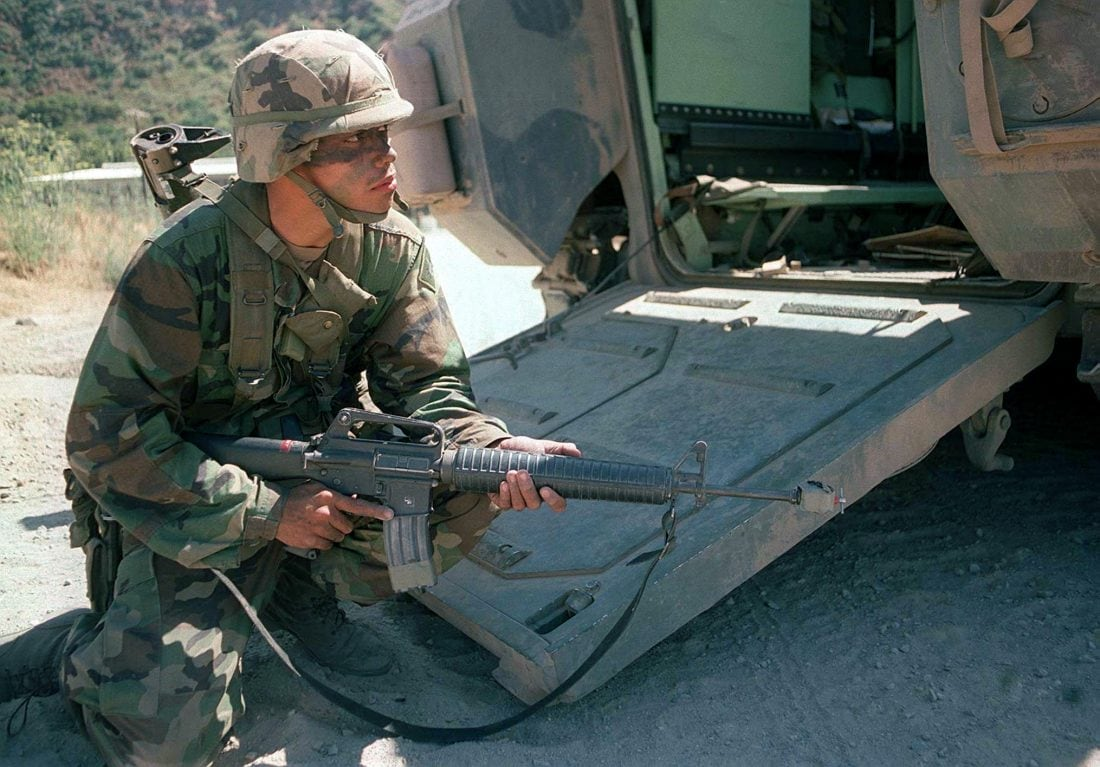 A soldier, armed with 5.56mm Colt M16A2, from the 3d Infantry Battalion, 160th Regiment, US Army National Guard, sets up a hasty defense after disembarking from a Bradley fighting vehicle during Military Operations in Urban Terrain (MOUT) operations, Exercise KERNEL BLITZ '97, June 28, 1997. (Photo & Caption: National Archives)