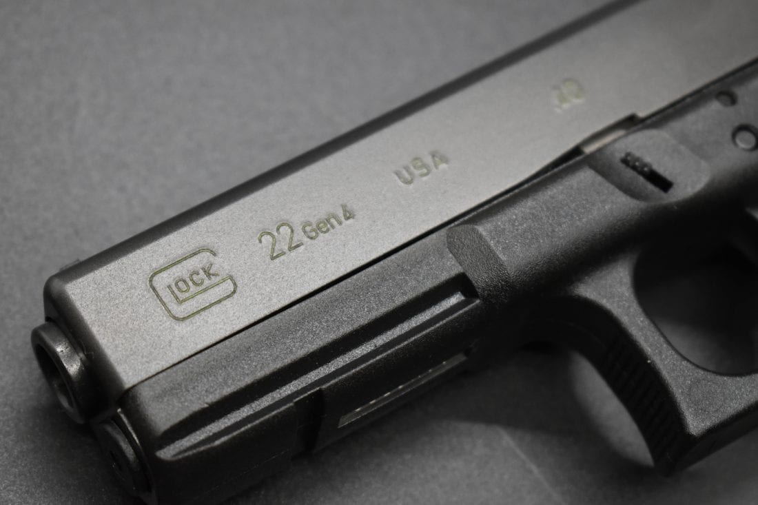 A 4th Gen Glock G22 on a black background