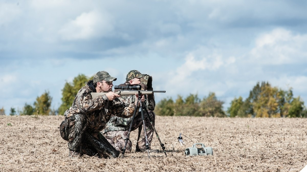 Two Men with a Ruger American rifle in the field
